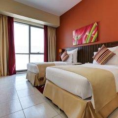 Abidos Hotel Apartment, Dubailand комната для гостей фото 4