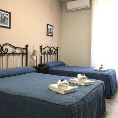 Отель Hostal El Pilar в номере фото 2