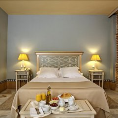 Alcazar De La Reina Hotel в номере