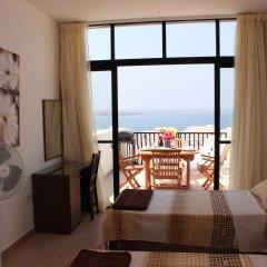 Отель Seashells Penthouse Буджибба комната для гостей фото 2