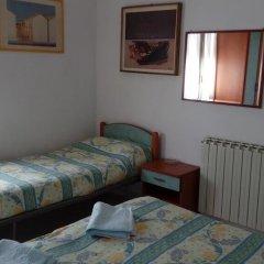 Отель Taormina B&B Римини сейф в номере