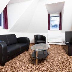 Отель Swiss Star Apartments Center Швейцария, Цюрих - отзывы, цены и фото номеров - забронировать отель Swiss Star Apartments Center онлайн комната для гостей фото 5