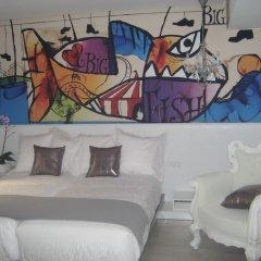 Отель Dormirdcine Cooltural Rooms Испания, Мадрид - отзывы, цены и фото номеров - забронировать отель Dormirdcine Cooltural Rooms онлайн комната для гостей фото 2