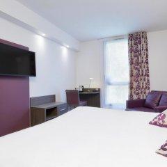 Отель Hôtel Kyriad Saint Quentin en Yvelines - Montigny Франция, Монтиньи ле Бретоне - отзывы, цены и фото номеров - забронировать отель Hôtel Kyriad Saint Quentin en Yvelines - Montigny онлайн удобства в номере