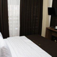 Отель Dahlia Tbilisi Тбилиси сейф в номере