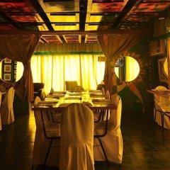 Отель Ponce Suites Gallery Hotel Филиппины, Давао - отзывы, цены и фото номеров - забронировать отель Ponce Suites Gallery Hotel онлайн питание фото 2