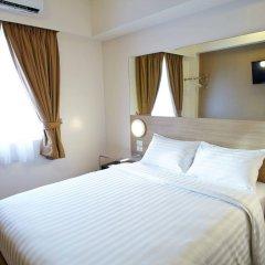 Отель Red Planet Manila Mabini Филиппины, Манила - 1 отзыв об отеле, цены и фото номеров - забронировать отель Red Planet Manila Mabini онлайн комната для гостей фото 4