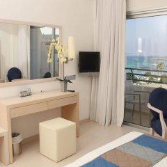 Отель Vrissiana Beach Hotel Кипр, Протарас - 1 отзыв об отеле, цены и фото номеров - забронировать отель Vrissiana Beach Hotel онлайн удобства в номере фото 2