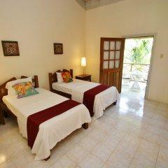 Отель White Sands Negril Ямайка, Саванна-Ла-Мар - отзывы, цены и фото номеров - забронировать отель White Sands Negril онлайн комната для гостей фото 5
