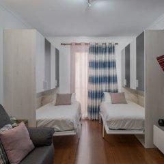 Отель Apartamento Lobo Marinho Португалия, Санта-Крус - отзывы, цены и фото номеров - забронировать отель Apartamento Lobo Marinho онлайн комната для гостей фото 4