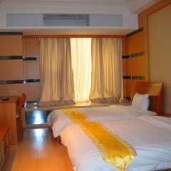 Апартаменты She & He Service Apartment - Huifeng сейф в номере