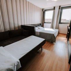 Отель Aparthotel Zenit Hall 88 комната для гостей