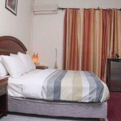 Отель ED Scob Suites Limited комната для гостей