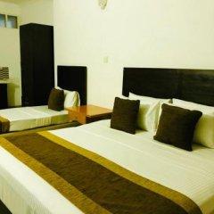 Отель Aradhana Airport Hotel Шри-Ланка, Негомбо - отзывы, цены и фото номеров - забронировать отель Aradhana Airport Hotel онлайн комната для гостей фото 4