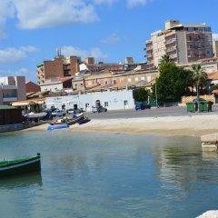 Отель Sbarcadero Hotel Италия, Сиракуза - отзывы, цены и фото номеров - забронировать отель Sbarcadero Hotel онлайн приотельная территория фото 2