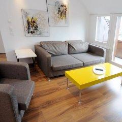 Апартаменты Luxury Apartments by Livingdowntown комната для гостей фото 5