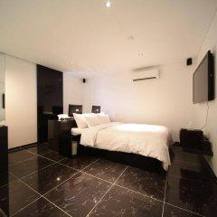 Отель POP1 Hotel Южная Корея, Сеул - отзывы, цены и фото номеров - забронировать отель POP1 Hotel онлайн сейф в номере