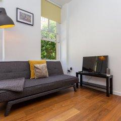 Апартаменты 1 Bedroom Apartment In Fitzrovia Sleeps 4 комната для гостей фото 4