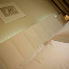 Отель Ferretti Beach Resort Римини сейф в номере