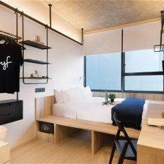 Отель lyf Funan Singapore by Ascott Сингапур комната для гостей фото 3