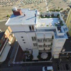 Hotel Belvedere Spiaggia Римини приотельная территория