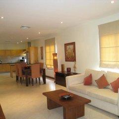 Апартаменты Baan Puri Apartments комната для гостей