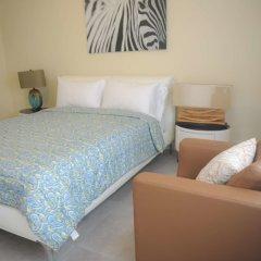 Апартаменты Lagoons Apartments комната для гостей фото 2