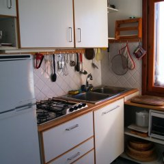 Отель Appartamento Profumo di Mare Костарайнера в номере