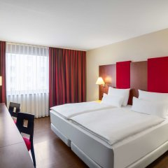 Отель Nh Wien Airport Conference Center Вена комната для гостей фото 4