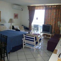 Отель Ocean Suite Beach Front at Mobay Club комната для гостей фото 2