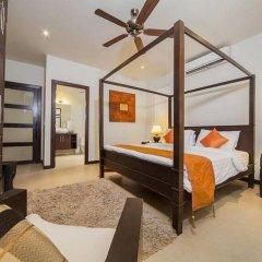 Отель Villa Ploi Attitaya 6 Bed 2 Storey Villa Near Nai Harn Beach Таиланд, Равай - отзывы, цены и фото номеров - забронировать отель Villa Ploi Attitaya 6 Bed 2 Storey Villa Near Nai Harn Beach онлайн комната для гостей фото 2