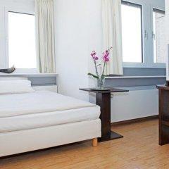 Отель Paragon Apartments Германия, Франкфурт-на-Майне - отзывы, цены и фото номеров - забронировать отель Paragon Apartments онлайн комната для гостей фото 3