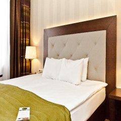 Гостиница Петро Палас 5* Стандартный номер с двуспальной кроватью фото 3