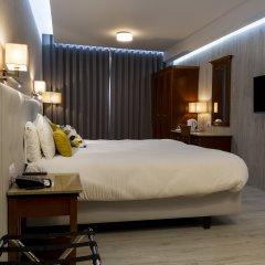 Solana Hotel & Spa Меллиха сейф в номере