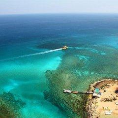 Отель Domniki Hotel Apts Кипр, Протарас - отзывы, цены и фото номеров - забронировать отель Domniki Hotel Apts онлайн пляж фото 2