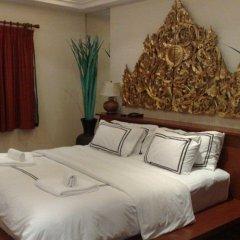 Отель Nirvana Boutique Suites Паттайя комната для гостей фото 2