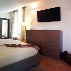 Апартаменты Navona Luxury Apartments комната для гостей фото 9