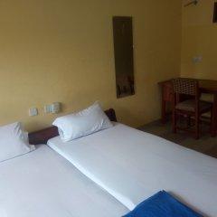 Отель Zito Guest Inn сейф в номере
