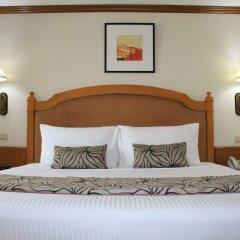 Отель Palm Grove Hotel Филиппины, Манила - отзывы, цены и фото номеров - забронировать отель Palm Grove Hotel онлайн комната для гостей фото 3