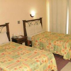 Plaza Palenque Hotel & Convention Center комната для гостей