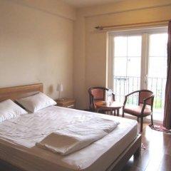Отель Moonlight Serviced Apartmnet Хошимин комната для гостей фото 4