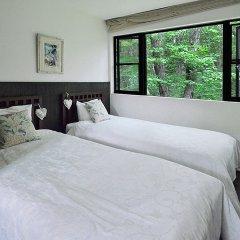 Отель Spa Greenness Минамиогуни комната для гостей фото 3