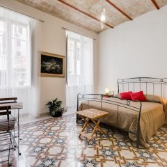 Апартаменты Monti Colosseum Apartment-Urbana комната для гостей