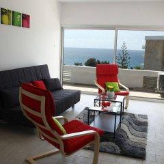 Апартаменты Anemos Apartments комната для гостей