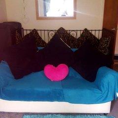 Апартаменты Sakina Apartment Эдинбург комната для гостей фото 3