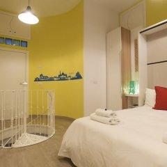Апартаменты Santi Quattro Apartment & Rooms - Colosseo комната для гостей фото 5