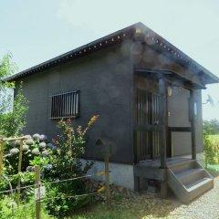 Отель Cottage Orange House Yakushima Якусима балкон