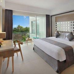 Отель Jimbaran Bay Beach Resort & Spa комната для гостей