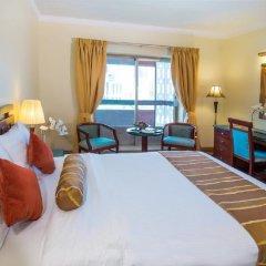 Отель Holiday International Sharjah комната для гостей фото 4