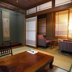 Отель Iyashi no Sato Rakushinkan Кикуйо комната для гостей фото 2